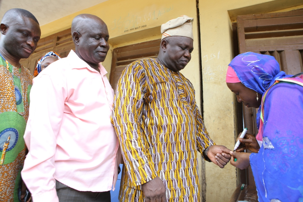 Akinwunmi Ambode Getting Accredited by an INEC staff
