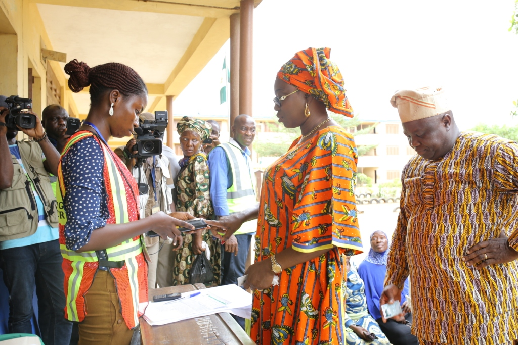 Mrs. Bolanle Ambode, the Wife of Mr. Akinwunmi Ambode Getting Accredited with the Card Reader